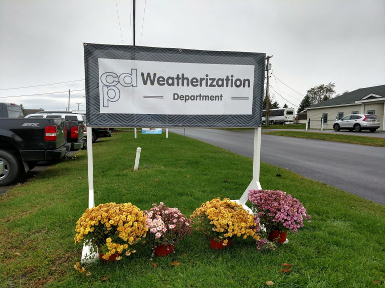 The Weatherization department canvas sign in front of the CDP office