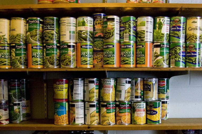 Shelves of canned foods at a neighborhood center